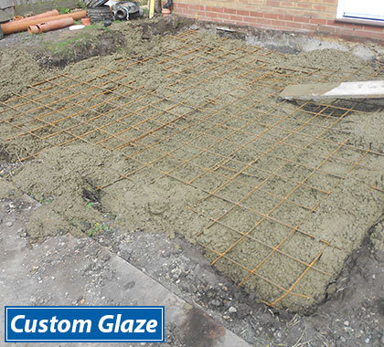 For raft bases, we excavate all the earth and fill with concrete and reinforce with steel mesh.