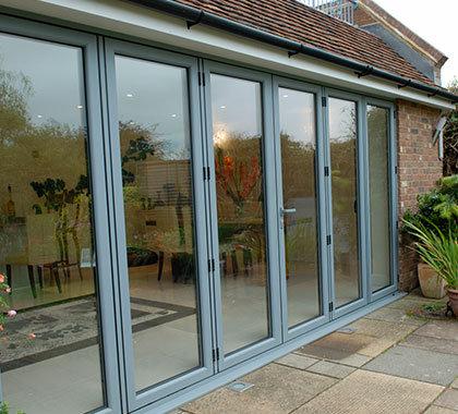 green aluminium bi fold doors